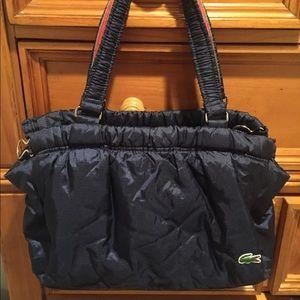 Lacoste 3 compartment purse. Like new.